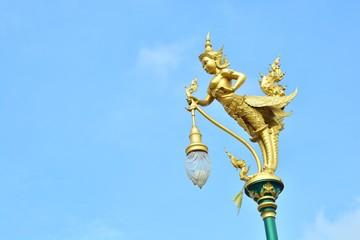 The lamp is a half-man, half-bird. Shaped.
