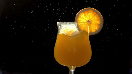 Ice Cubes in Orange Juice