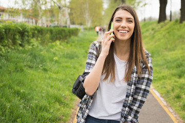 Student girl talking on the phone laughing No retouch
