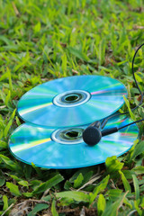 compact disc and earphone