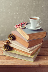 Christmas holiday tea cup on old books