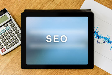 SEO or search engine optimization word on digital tablet