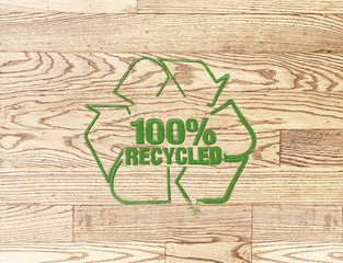recycled sign stamp on wood plank background