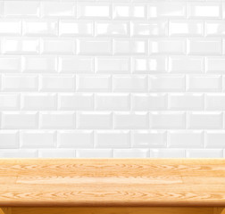 Empty wood table and ceramic tile brick wall in background. prod