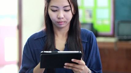 thai woman using tablet