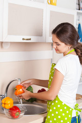 Young Woman Cooking in the kitchen. Healthy Food. Dieting Concep