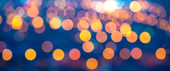 merry christmas lights abstract circular bokeh on blue backgroun