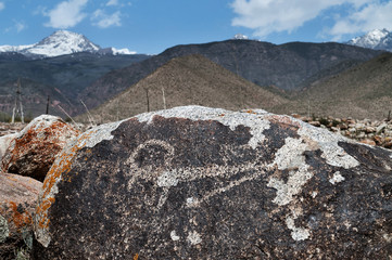 Ancient petroglyph on the stone