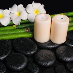spa concept of zen basalt stones, three white flower frangipani,