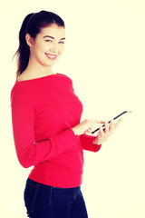 Young caucasian woman using tablet computer