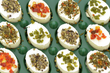 Close-up of cheese appetizers decorated  on green