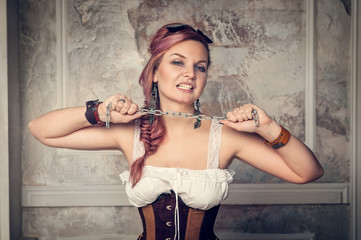 Beautiful steampunk woman with metal chain