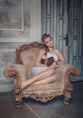 Beautiful steampunk woman on the armchair