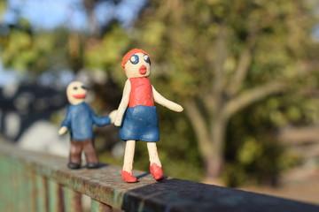 Funny plasticine  man runs for plasticine woman