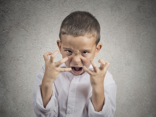 headshot angry child, Boy Screaming hysterical grey background
