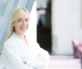 happy confident female doctor healthcare professional hospital