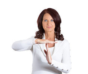 smiling woman showing time out gesture on white background