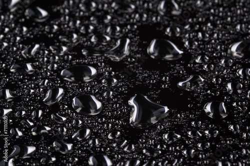 Fototapeta abstract water drops on polished stainless steel surface