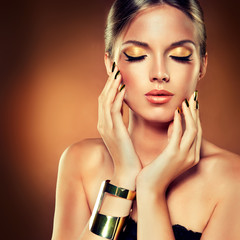 Girl with the Golden makeup and metal nails.
