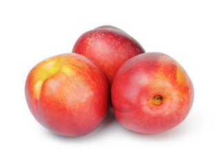 three ripe whole nectarines