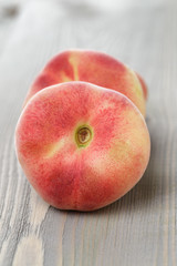flat peaches on wood table