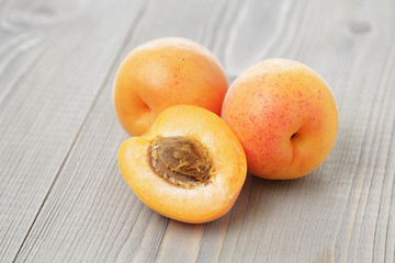 ripe juicy apricots on wooden table