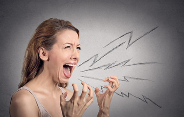Portrait angry woman screaming isolated on grey background
