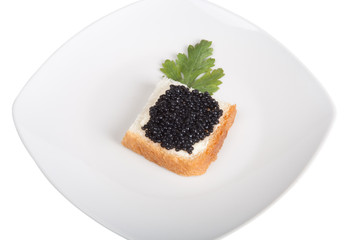 Bread with butter and caviar isolated on a white background
