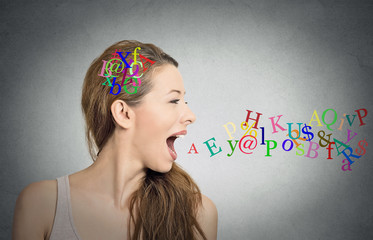 woman talking letters in her head coming out of mouth