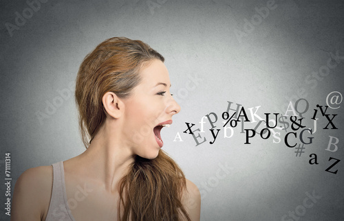 Leinwanddruck Bild woman talking with alphabet letters coming out of mouth