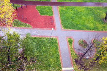 New playground outdoor in a city in wet autumn day