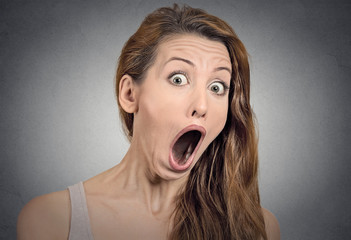 Surprise astonished woman with shocked face expression