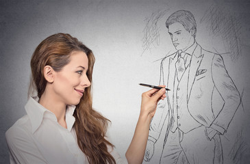 woman stylist drawing with pen male model in full suit