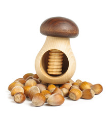 Mushroom shape nut cracker on the hazelnuts