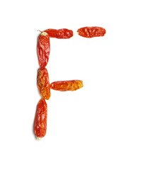 Alphabet letter F arranged from chili peppers isolated