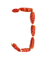 Alphabet letter J arranged from chili peppers isolated