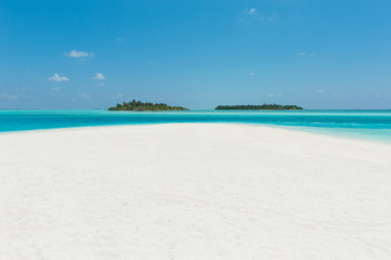Two islands in the ocean, beach with white sand and blue water