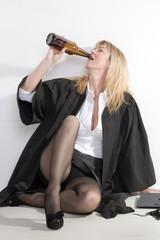 University student drinking beer from bottle