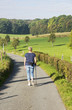 woman walking on countryside