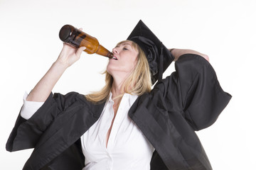 Mature female university student drinking beer