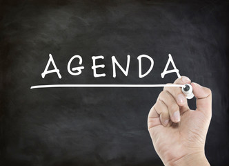agenda with hand writing on blackboard