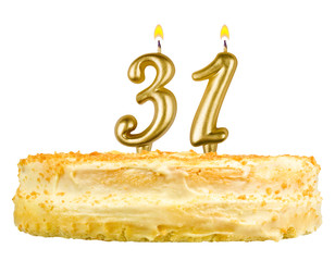 birthday cake with candles number thirty one isolated on white
