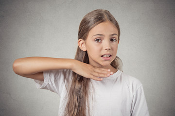 Upset angry girl gesturing with hand stop talking, cut it out