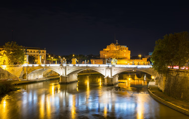 Night view of Castle Sant Angelo and river Tiber in Roma. Italy