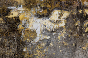 Old plastered surface of yellow and gray