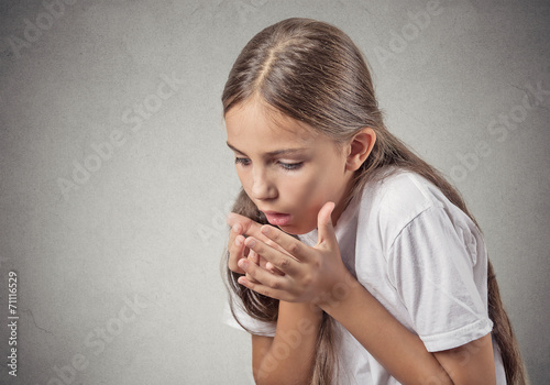 Headshot teenager girl sick about to throw up on grey background - 71116529