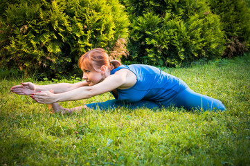 Beautiful woman practicing fitness or yoga