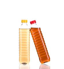 Bottles full of vinegar.