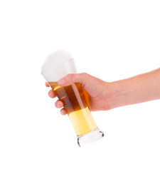 Hand holding goblet of beer.