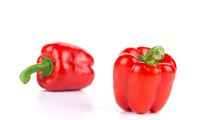 Two ripe red bell peppers.